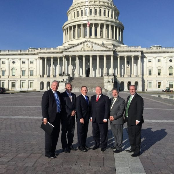 Men in Washington meeting on clean energy initiatives